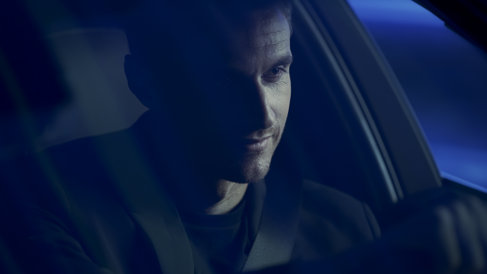 Screenshot of man driving Vinfast Lux A2.0 from 'Vinfast - Between Worlds' TV commercial